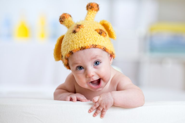happy baby or child in giraffe costume