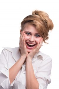 portrait of surprised girl with nice hairstyle