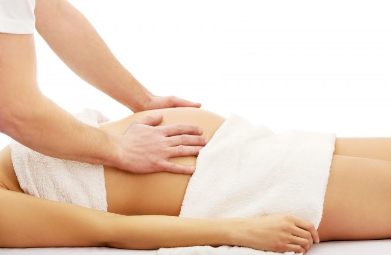 Pregnant woman having a massage on her belly