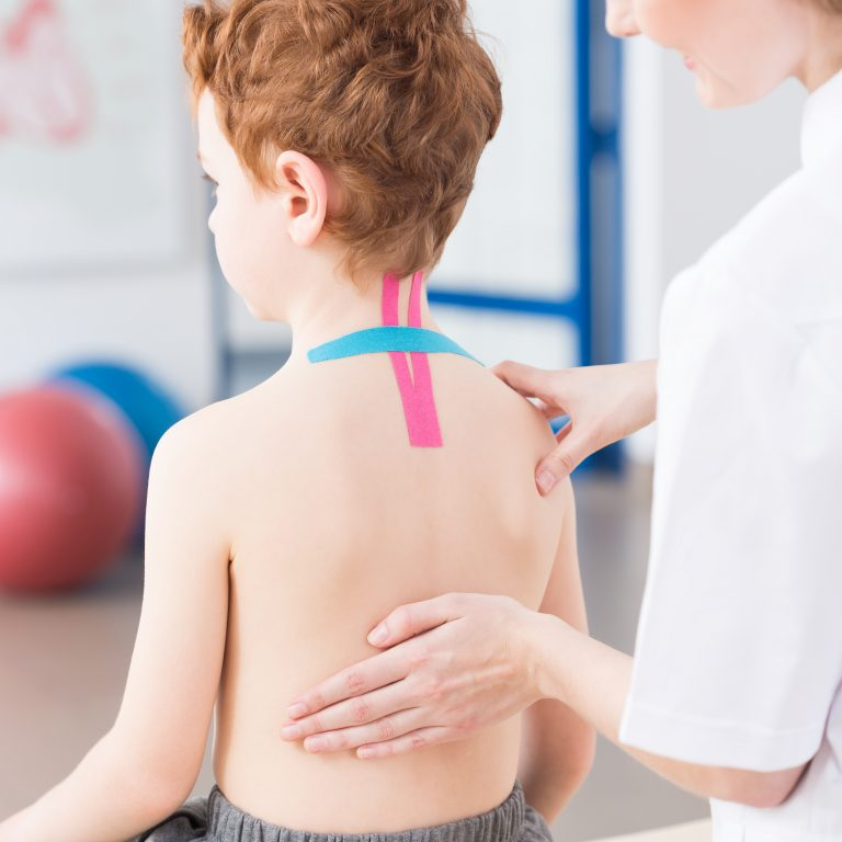 Child with back pain in rehabilitation clinic